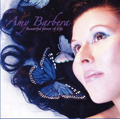 Featured Artist - Amy Barbera - Check Out Amy's original song 'Make Me A Butterfly' & the epic dance remix of 'Make Me A Butterfly' as well! Her song 'Make Me A Butterfly' is featured on Amy's debut album 'Beautiful Flower of Life' that was released in 2008. She is currently working on her 2nd album which will be titled 'Paint Me A Rainbow' and Amy hope's to have it released by early 2012. Also check out Amy's new dance song 'Paint Me A Rainbow' & the Dance remix of my song 'Electric Church' too. Search the playlist under 'A' and click it to play it. The Music You Want is on Radio WHAT at http://www.radioWHAT.com/.